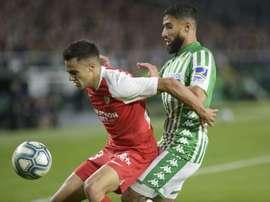 Reguilon (L) has had a great year at Sevilla. AFP