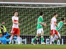 Le défenseur irlandais Ciaran Clark (D) célèbre son but face à la Suisse lors du match amical, le 25 mars 2016 à Dublin