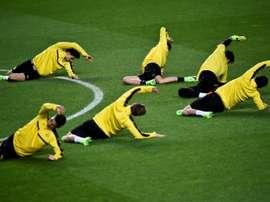 L'échauffement des joueurs du Borussia Dortmund sur la pelouse du Benfica. AFP