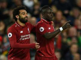 Carragher said who he preferred out of Mane and Salah. AFP