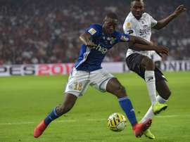 Ibrahima Sissoko (L) could move to Newcastle. AFP