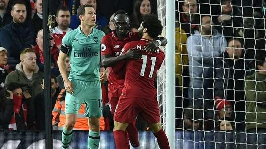 Rooney couvre d'éloges les Reds. AFP