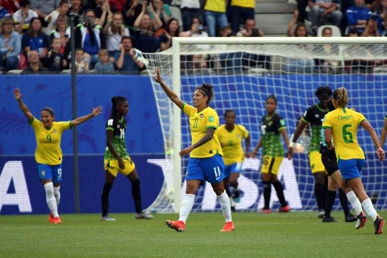 Cristiane marcou os três gols da vitória na estreia. AFP