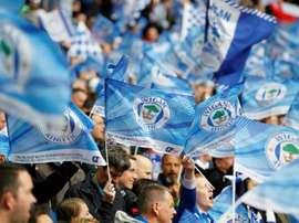 La Ligue de football anglaise va enquêter sur le dépôt de bilan de Wigan. AFP
