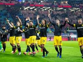 Les joueurs de Dortmund jubilent lors de la victoire à Leipzig. AFP