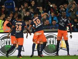 Lattaquant montpelliérain Casimir Ninga (N.29) fête avec ses coéquipiers un de ses 2 buts contre Caen à La Mosson, le 15 octobre 2016