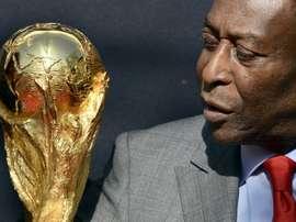 Confiné en raison du coronavirus, Pelé fête ses 80 ans avec humour. AFP