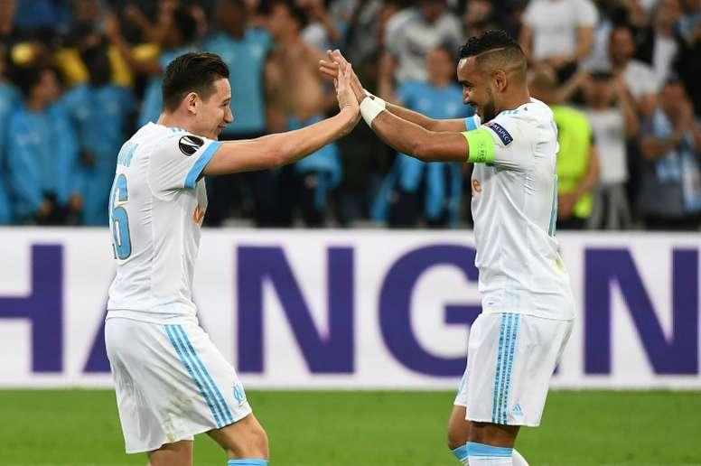 Thauvin y Payet, peligros frente al Atlético. AFP