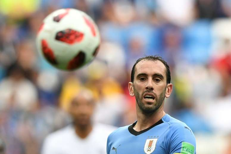 126 sélections pour Godin. AFP