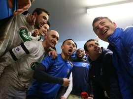 Les joueurs de Granville fêtent leur qualification pour les quarts de la Coupe de France. AFP