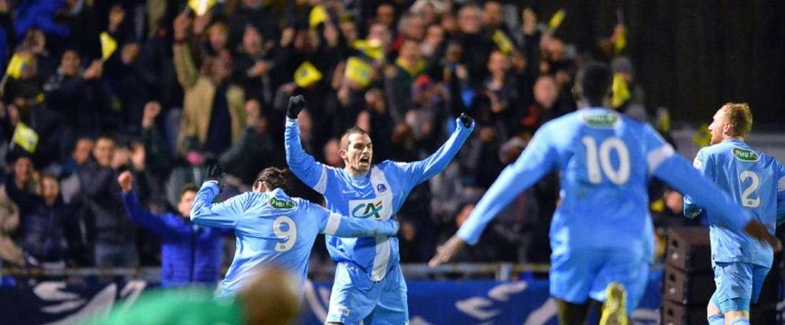 Les joueurs de Trélissac exultent après légalisation face à Lille en Coupe de France, le 20 janvier 2016 à Périgueux