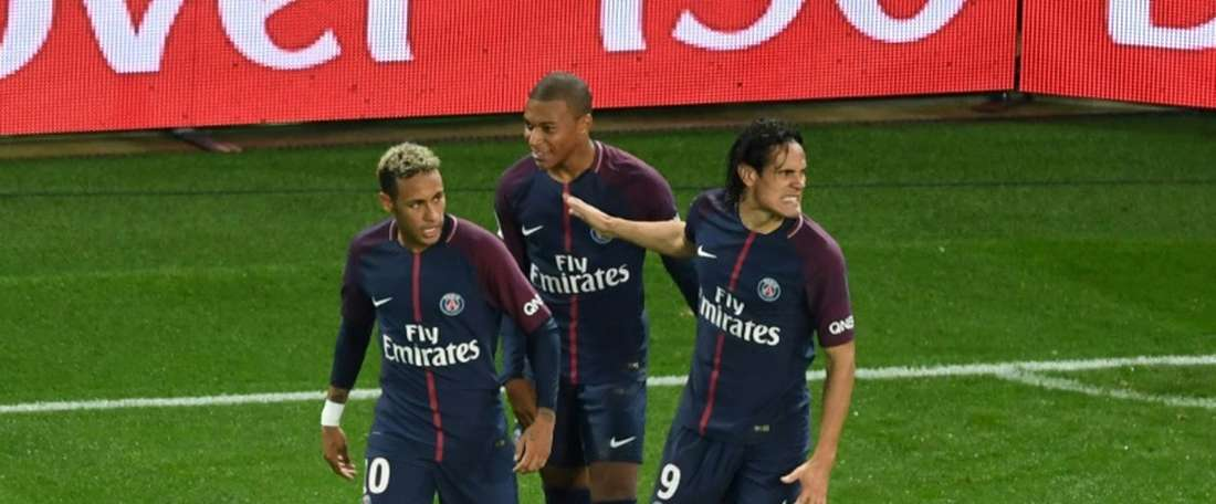 PSG's front three celebrate during their 2-0 win over Lyon. AFP