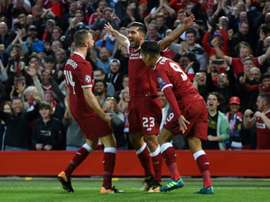 Emre Can scored twice, as Liverpool secured their place in this year's Champions League. AFP