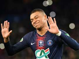 Mbappe says he is not as good as Messi and Ronaldo. AFP