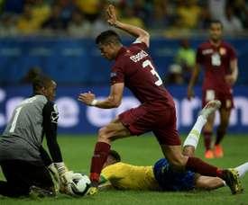 La défense du Venezuela, Wuilker Farinez et Yordan Osorio et les attaquants du Brésil. 18/06/19 AFP