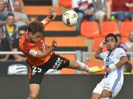 Le défenseur brésilien de Lyon Rafael lors d'un match face à Lorient. AFP