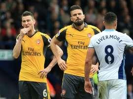 Dupla 'gunner' poderia rumar à Ligue 1. AFP
