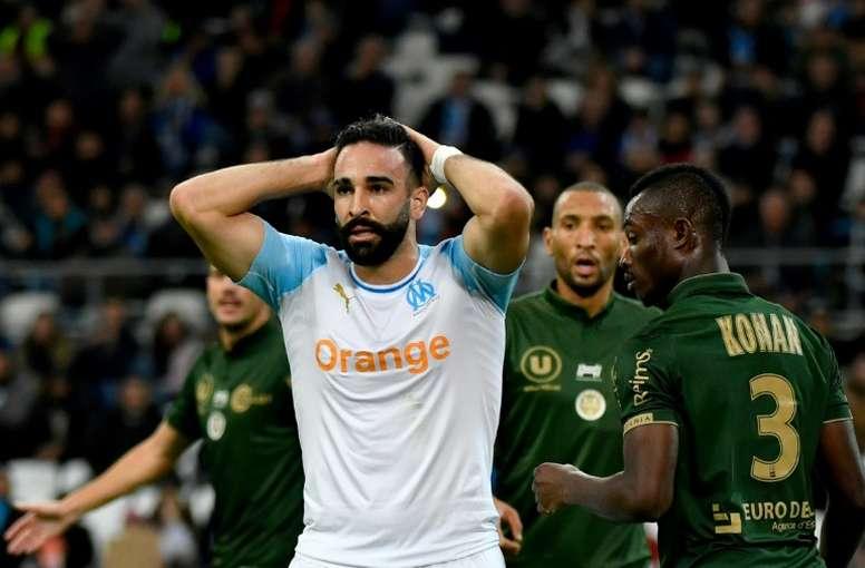Adil Rami dépité après avoir raté un but lors du match contre Reims. AFP