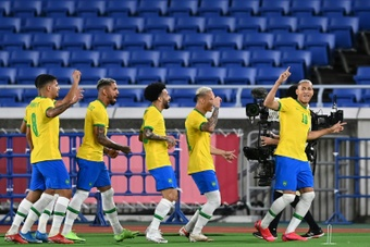 Richarlison (R) scored a hat-trick in thirty first-half minutes. AFP
