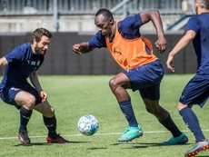 Usain Bolt va se lancer dans une carrière de footballeur. AFP