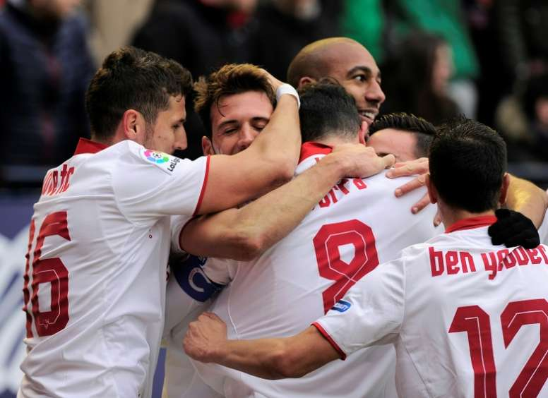 Sevilla players celebrating a goal. AFP