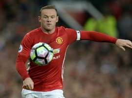 Rooney will be given a go in a more familiar number nine role. AFP