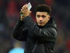 Sancho praises Pep Guardiola despite his controversial Man City exit. AFP