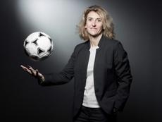 La pionnière du football féminin français. AFP