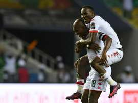 Burkina's Kabore and Cyrille Bayala celebrating a goal against Tunesia. AFP