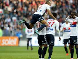 Lyon players celebrate a goal against Nice. AFP