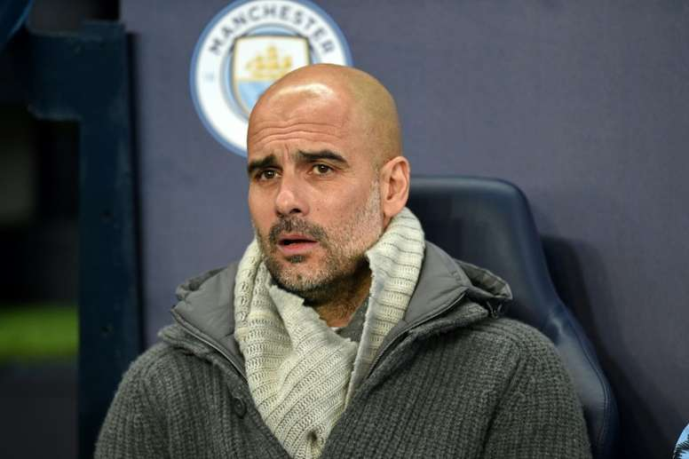 Guardiola will not be able to make any signings for 15 months. AFP