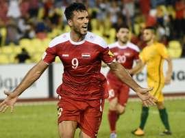 L'attaquant syrien Omar al-Soma buteur sur penalty face à l'Australie. AFP