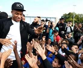 Mbappe was welcomed back to hometown Bondy. AFP