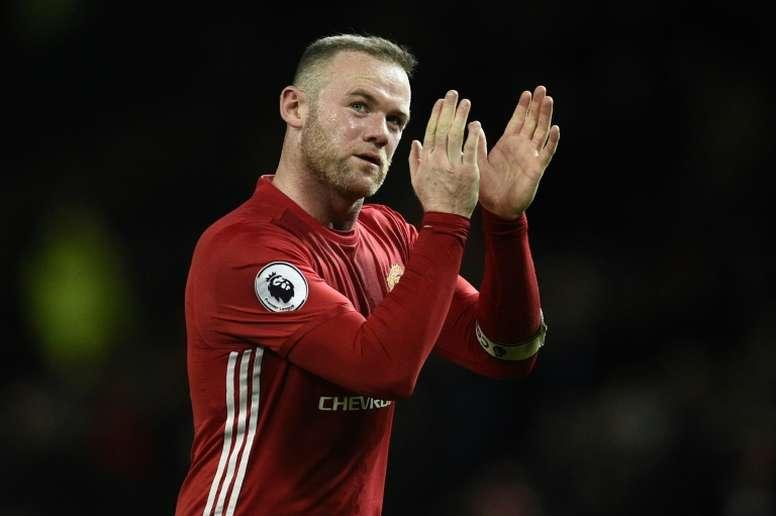 Rooney celebrating a goal. AFP