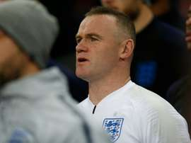 Rooney prepares to come on. AFP