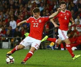 Woodburn scored on his Wales debut. AFP