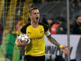 Marco Reus scored twice as Dortmund maintain their unbeaten record in the Bundesliga. AFP