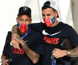 Neymar e Leandro Paredes falaram sobre o desejo de atuar com Messi. AFP