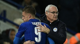 Ranieri embraces Jamie Vardy when leaving the field during a Champions League fixture. AFP