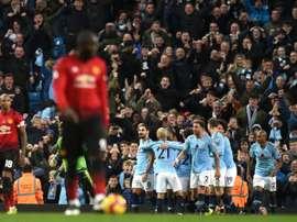 Manchester City remporte le derby. AFP