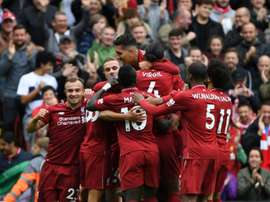 Liverpool players celebrate during victory over Southampton. AFP