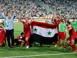 Les joueurs syriens en liesse après avoir décroché un ticket pour un pré-barrages. AFP
