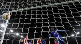 Gunners crash out in Europa League after late El-Arabi shocker. AFP
