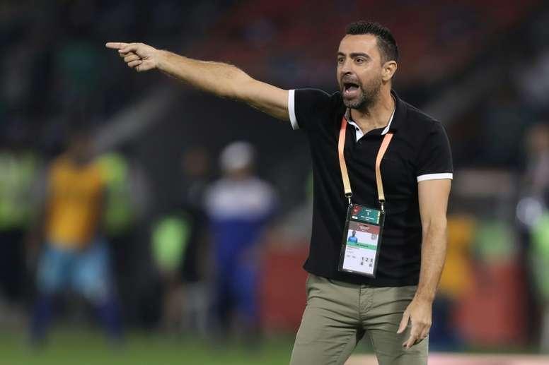 Xavi says he wants to return to Barcelona. AFP