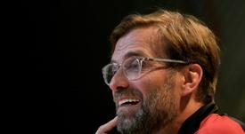 Klopp reflejó su felicidad por ser entrenador del Liverpool. AFP