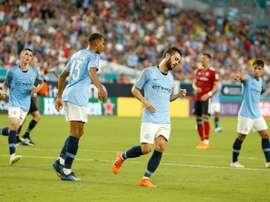 City perd un joueur mais gagne le match. AFP