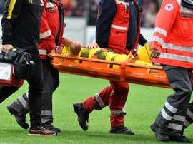 O capitão do B. Dortmund saiu lesionado do encontro com o Friburgo. AFP