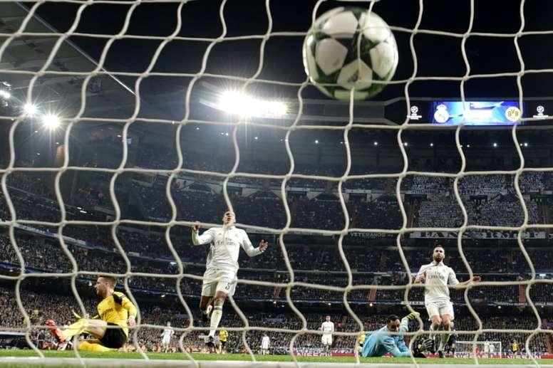 Reus puts the ball past Navas at the Bernabeu. AFP