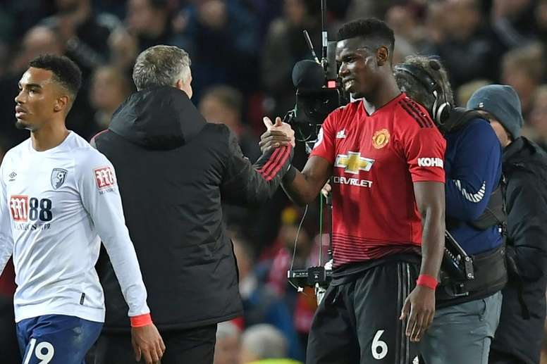 Solskjaer admitted Pogba will play a lot more with United. AFP