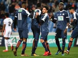 Les joueurs de Montpellier se congratulent après un but face à Lorient. AFP